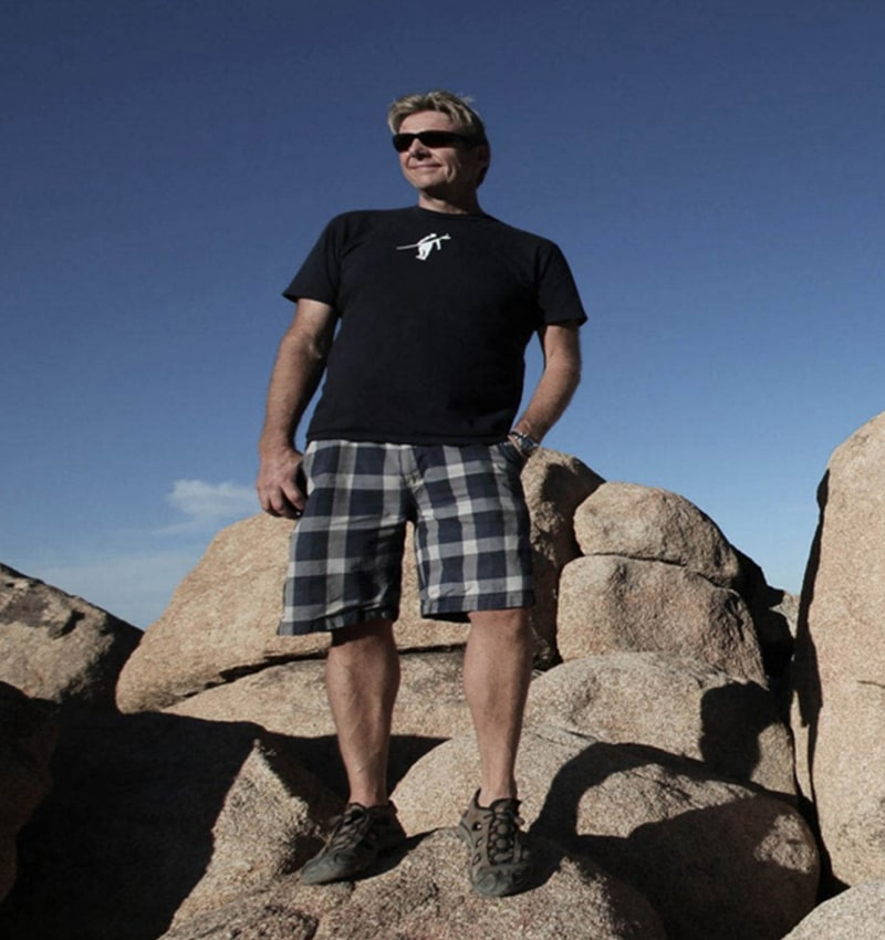 Charlie Webb standing on large rocks